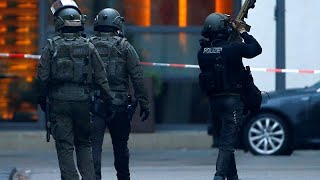 Shots fired in downtown Cologne, police arrest one and hunt is on for others