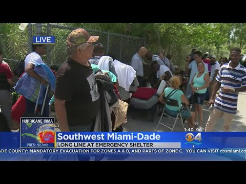 Long Lines Form To Get Into Dade Shelters
