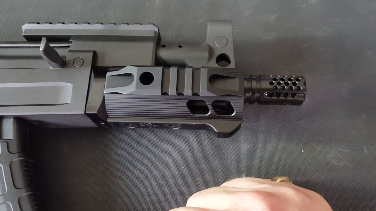 C39 Micro with SLR handguard and Mini Comp vs  Troy P7A1