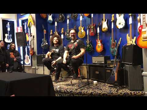 Rob Chapman and Rabea Massaad visits Union Square Guitar Center in New York City