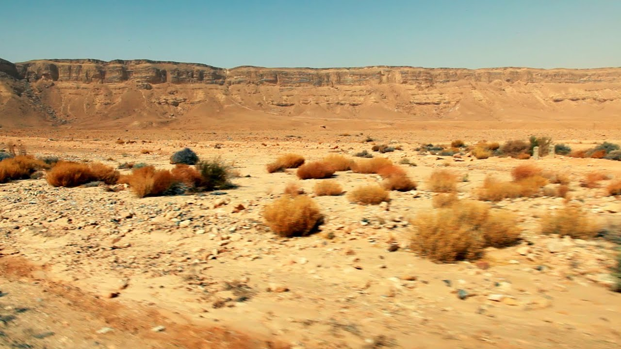 stock footage drive by of the makhtesh ramon desert floor in israel