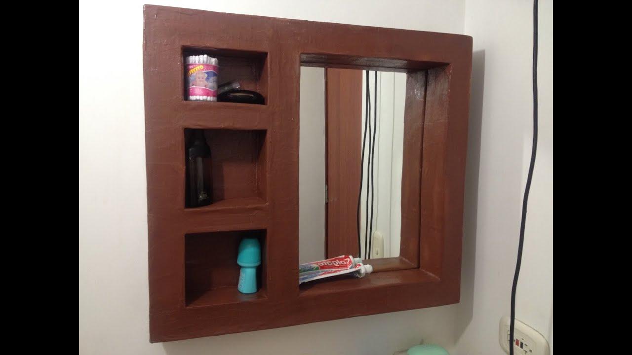 Tutorial como hacer mueble de carton espejo organizador for Pared con espejos redondos