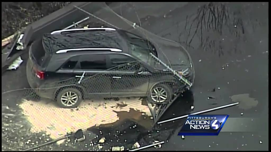 Aerial View Sky Flies Over Scene Of Suv On Giant Eagle Roof