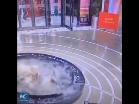 Woman obsessed with cellphone walks straight into pool in Beijing