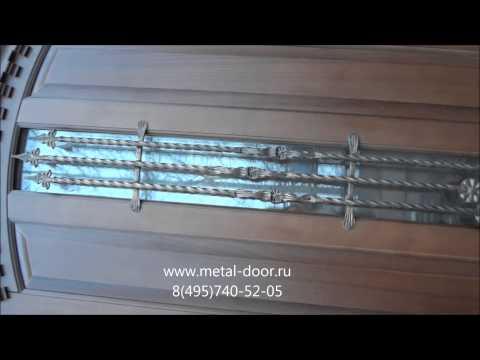 Металлические двери со стеклопакетом и ковкой