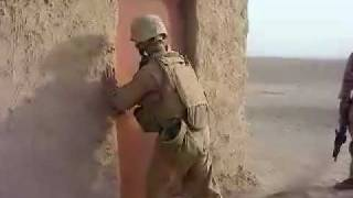Marine Kicking Down Door