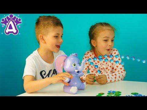 Слоненок пускающий фонтан Игры для детей Распаковка. Elly Fountain Game Распаковка. Розыгрыш игрушки