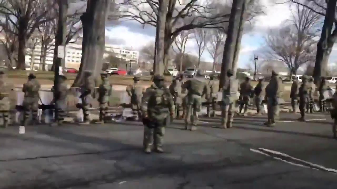 Military turns backs to Joe Biden's motorcade.