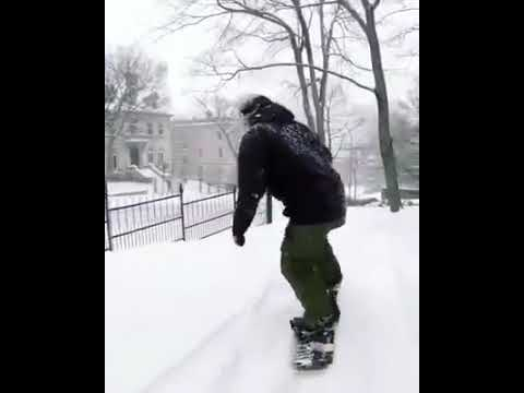 Snowboarding down streets of Canada Montreal