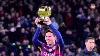 Messi offers the ballon d'or to fc barcelona supporters at camp nou