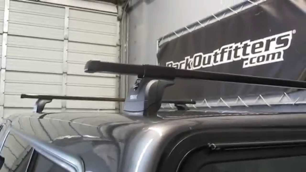 truck cap camper shell with thule podium fixed point roof rack by rack outfitters