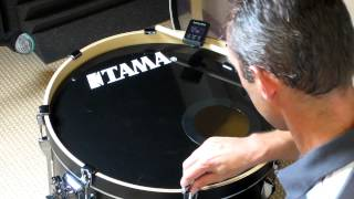 Tuning a kick drum with a tune-bot