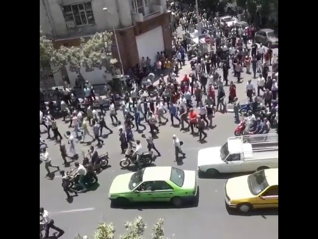 TEHRAN, Iran, June 25, 2018. Protesters chanting: Iranians, enough is enough, show your pride