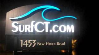 SurfCT.com New Office Sign.   Lit up for the first time on a rainy night
