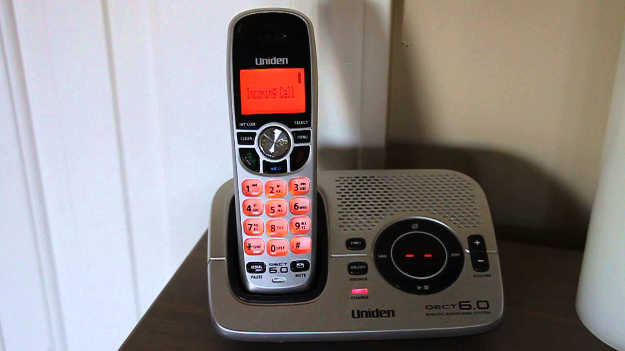 how to get batteries out of uniden telephones