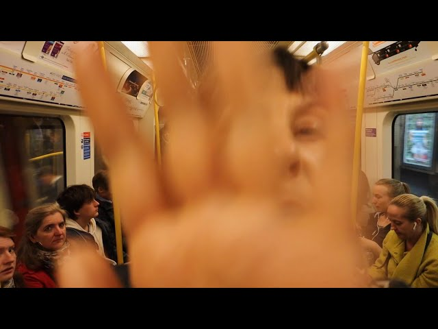 Angry woman grabs camera as we preach Christ on a London train