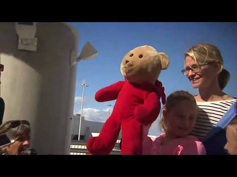 Young girl reunited with teddy bear after Fort Lauderdale airport shooting