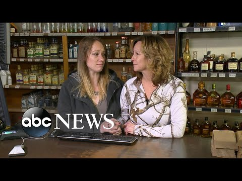 A mother and daughter fighting back against an armed robbery