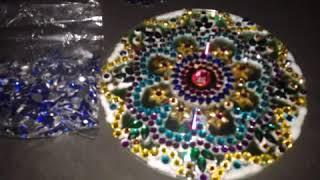 Rangoli design with kundan stones on CD