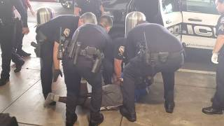 Part 2 man resisting arrest man Calls lapd 911 and says he has a gun in his  backpack at laxpd