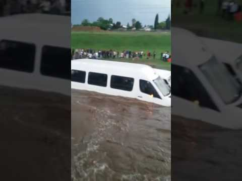 Flash flood submerges taxi