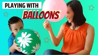 Rei and Mom playing with Balloons