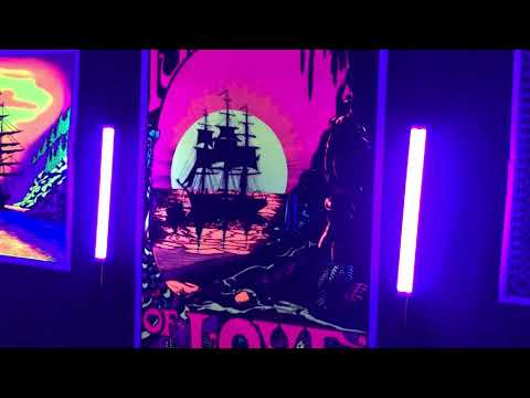 Blacklight posters with Styx Castle Walls playing.