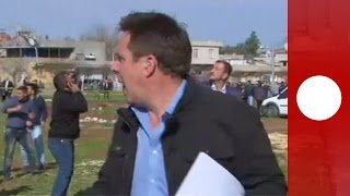 Shells fall during live TV broadcast in Turkey border town
