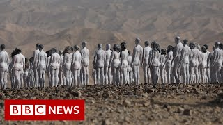 Hundreds strip naked by the Dead Sea in Israel - BBC News
