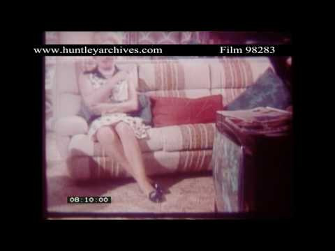 Woman distractedly watches television.  Archive film 98283
