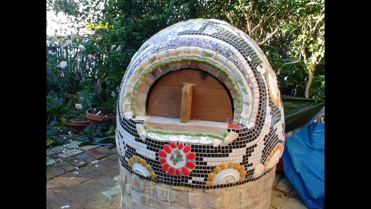 making wood fired clay earth cob pizza oven with mosaic deco