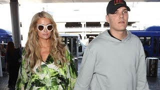 Paris Hilton And Chris Zylka Holding Hands For Air Travel