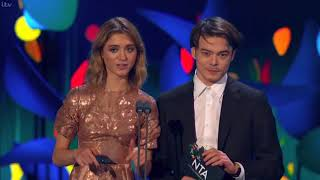 Charlie Heaton and Natalia Dyer presenting at the NTAs 2018