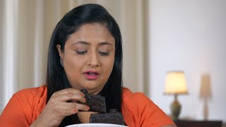 Indian overweight woman in dilemma whether she should eat a cake - Dieting concept