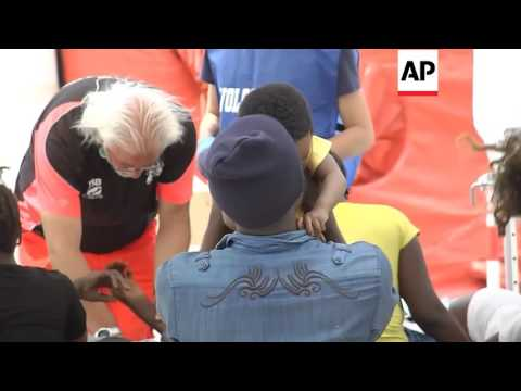 Italy - Bodies of dead migrants taken off ship  Editor's Pick   29 May 16