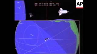 SPACE: SHUTTLE COLUMBIA CREW SECURE WAYWARD SATELLITE