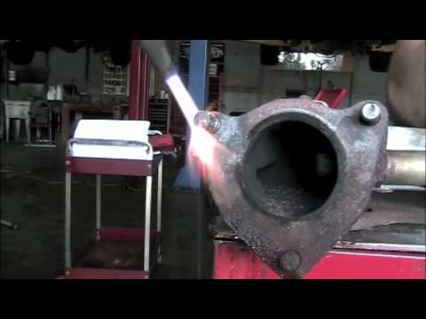 Removing broken exhaust studs - YouTube