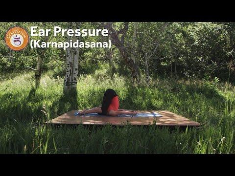 Ear Pressure Pose (Karnapidasana)