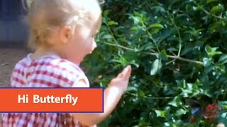 Little Girl Says Hi To Butterfly