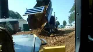 Kenworth  dump truck dumping dirt