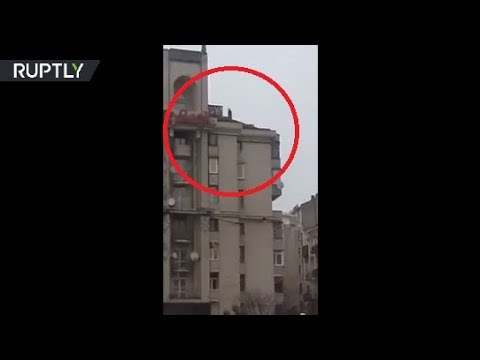 Moment Georgia's ex-leader Saakashvili threatens to jump off roof in Kiev