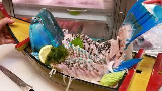 Comida de Rua-Lanches na estrada no Japão - Sashimi de peixe enorme Napoleon