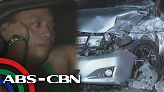 Highway cop hits dump truck, concrete barrier