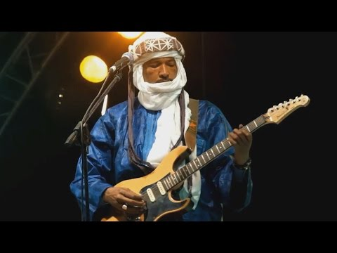 Faces Of Africa - A Gun for a Guitar