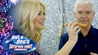 Phillip Schofield and Holly Willoughby Play Sling a Sausage!