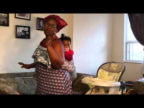 How to Carry a baby the African/Nigerian way with the African wax wrapper.