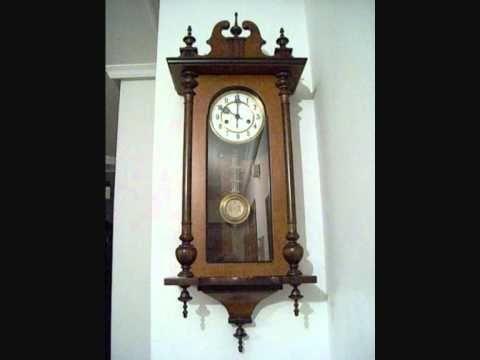Reloj antiguo de péndulo