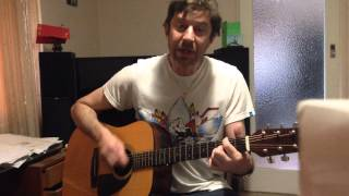 J plays She Makes My Day (Robert Palmer) on acoustic guitar