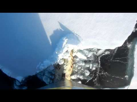Ship's bow cutting through pack ice