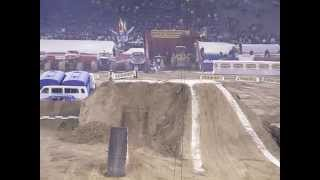 People riding Dirt Bikes doing stunts. Monster Jam - Dirt Track